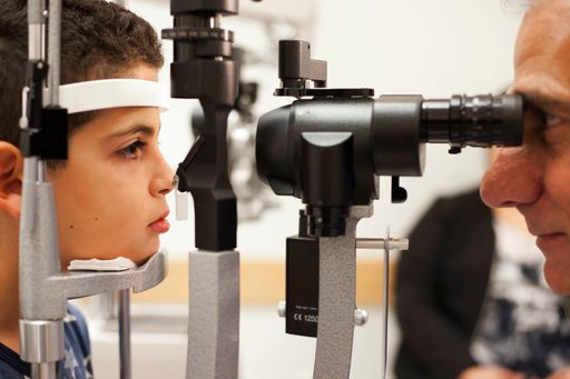 (AP Photo/Bill West, File). FILE - In this Oct. 4, 2017, file photo, Dr. Albert Maguire, right, checks the eyes of Misa Kaabali, 8, at the Children's Hospital of Philadelphia. Misa was 4-years-old when he received his gene therapy treatment. On Tuesday...