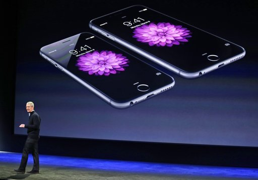 (AP Photo/Eric Risberg, File). FILE - In this March 9, 2015 file photo, Apple CEO Tim Cook talks about the iPhone 6 and iPhone 6 Plus during an Apple event in San Francisco. IPhone owners from several states sued Apple Inc. for not disclosing sooner th...