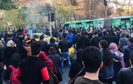 (AP Photo). This photo taken by an individual not employed by the Associated Press and obtained by the AP outside Iran, demonstrators attend a protest over Iran's weak economy, in Tehran, Iran, Saturday, Dec. 30, 2017. A wave of spontaneous protests ov...