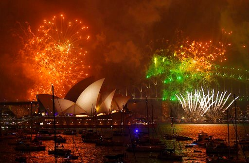 (David Moir/AAP Image via AP). Fireworks explode over Sydney Harbour during New Year's Eve celebrations in Sydney, Australia, Sunday, Dec. 31, 2017.