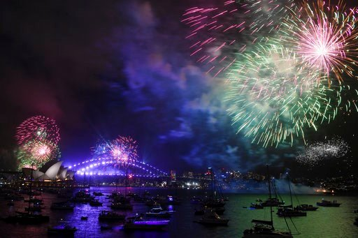 (David Moir/AAP Image via AP). Fireworks explode over Sydney Harbour during New Year's Eve celebrations in Sydney, Sunday, Dec. 31, 2017.