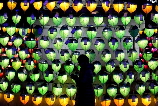 (AP Photo/Ahn Young-joon). A woman prays in front of lanterns to celebrate the New Year at Jogyesa Buddhist temple in Seoul, South Korea, Sunday, Dec. 31, 2017. .