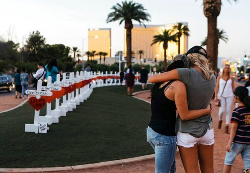 (Mikayla Whitmore/Las Vegas Sun via AP, File). FILE - In this Oct. 5, 2017, file photo, a memorial displaying 58 crosses by Greg Zanis stands at the Welcome To Las Vegas Sign in Las Vegas. Each cross has the name of a victim killed during the mass shoo...