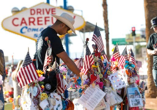 "(Richard Brian/Las Vegas Review-Journal via AP, File). FILE - In this Nov. 10, 2017, file photo, Route 91 Harvest shooting survivor Jason Zabala of San Diego, Calif., visits the memorial for victims of the Route 91 shooting at the ""Welcome to Fabulous ..."