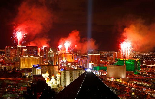 (AP Photo/John Locher, File). FILE - In this Jan. 1, 2015, file photo, fireworks explode above the Strip to ring in the new year in Las Vegas. Tens of thousands of revelers will ring in the New Year in Las Vegas under the close eye of law enforcement j...