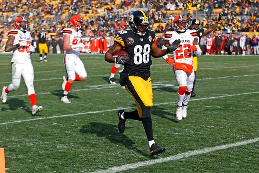 (AP Photo/Keith Srakocic). Pittsburgh Steelers wide receiver Darrius Heyward-Bey (88) scores during the first half of an NFL football game against the Cleveland Browns in Pittsburgh, Sunday, Dec. 31, 2017.