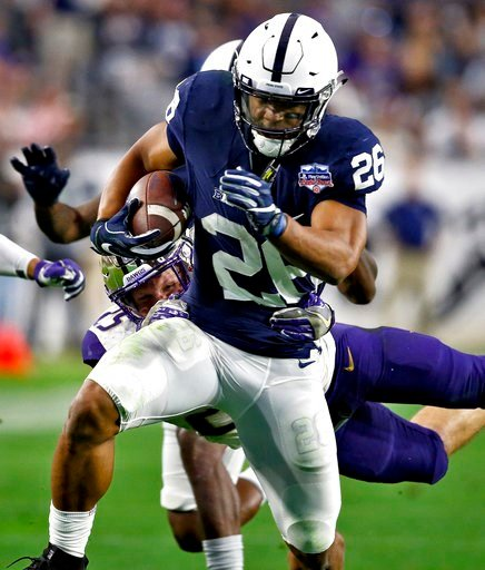 (AP Photo/Ross D. Franklin). Penn State running back Saquon Barkley (26) carries as Washington linebacker Ben Burr-Kirven reaches for a tackle during the second half of the Fiesta Bowl NCAA college football game Saturday, Dec. 30, 2017, in Glendale, Ar...