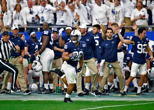 (AP Photo/Ross D. Franklin). Penn State running back Saquon Barkley (26) breaks free for a 92-yard touchdown run during the first half of the Fiesta Bowl NCAA college football game against Washington, Saturday, Dec. 30, 2017, in Glendale, Ariz.