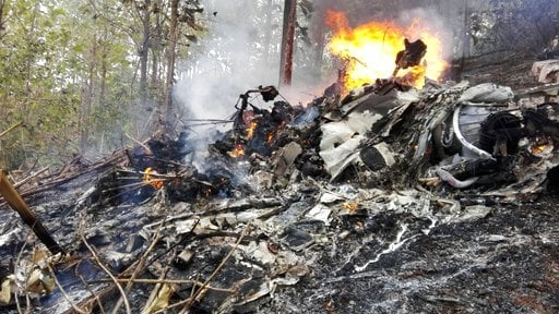 (Costa Rica's Civil Aviation press office via AP). This photo released by Costa Rica's Civil Aviation press office shows the site of a plane crash in Punta Islita, Guanacaste, Costa Rica, Sunday, Dec. 31, 2017.