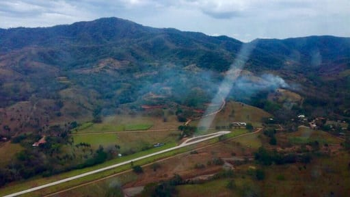 (Costa Rica's Public Safety Ministry via AP). This photo released by Costa Rica's Public Safety Ministry shows smoke rising from the site of a plane crash near an air strip in Punta Islita, Guanacaste, Costa Rica, Sunday, Dec. 31, 2017.