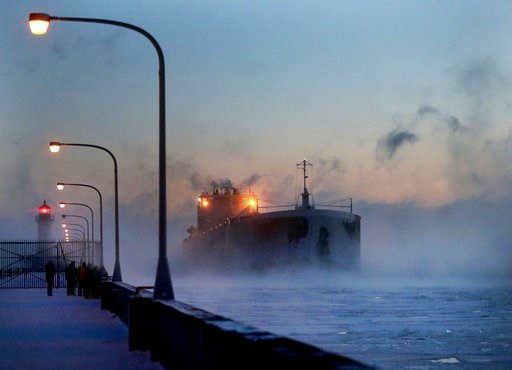 (David Joles/Star Tribune via AP). Steam rises from Lake Superior as the ship St. Clair comes to harbor during some of the coldest temps of the year, Sunday, Dec. 31, 2017, at Canal Park in Duluth, Minn.