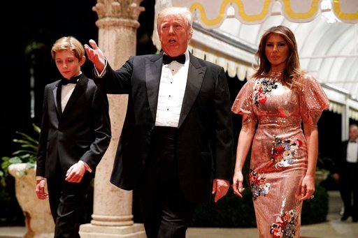 (AP Photo/Evan Vucci). President Donald Trump, first lady Melania Trump, and their son Barron arrive for a New Year's Eve gala at his Mar-a-Lago resort Sunday, Dec. 31, 2017, in Palm Beach, Fla.