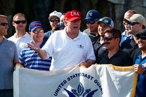 (AP Photo/Evan Vucci). President Donald Trump speaks as he meets with members of the U.S. Coast Guard, who he invited to play golf, at Trump International Golf Club, Friday, Dec. 29, 2017, in West Palm Beach, Fla.