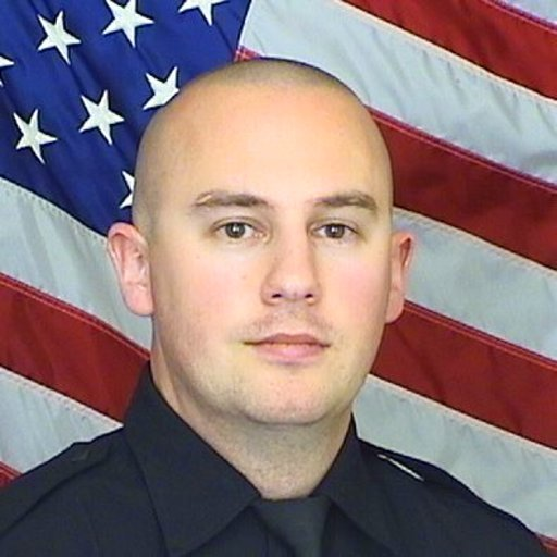 (Douglas County Sheriff's Office via AP). This undated photo provided by the Douglas County Sheriff's Office shows Sheriff's Deputy Zackari Parrish.