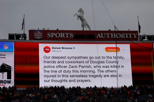 (AP Photo/Joe Mahoney ). A sign expresses condolences for police officers Zack Parrish, who was killed in the line of duty Sunday morning, before an NFL football game between the Denver Broncos and the Kansas City Chiefs Sunday, Dec. 31, 2017, in Denver.