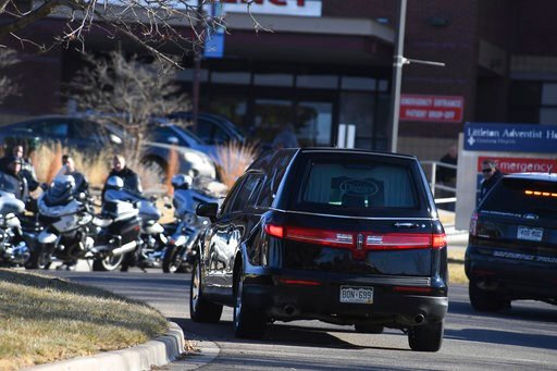 (John Leyba/The Denver Post via AP). A hearse arrives at Littleton Hospital as officers from various police agencies line up for a procession for an officer who was fatally wounded in a domestic incident in a Highlands Ranch apartment complex in Denver.