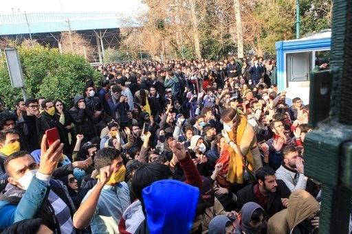 (AP Photo). In this photo taken by an individual not employed by the Associated Press and obtained by the AP outside Iran, university students attend a protest inside Tehran University while anti-riot Iranian police prevent them to join other protestor...