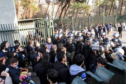 (AP Photo). In this photo taken by an individual not employed by the Associated Press and obtained by the AP outside Iran, anti-riot Iranian police prevent university students to join other protesters over Iran weak economy, in Tehran, Iran, Saturday, ...