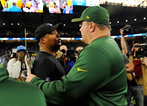 (AP Photo/Jose Juarez). Detroit Lions head coach Jim Caldwell, left, meets with Green Bay Packers head coach Mike McCarthy after an NFL football game, Sunday, Dec. 31, 2017, in Detroit.