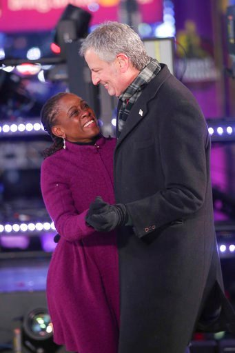 (Photo by Brent N. Clarke/Invision/AP). Chirlane McCray, left, and New York City Mayor Bill de Blasio dance on stage at the New Year's Eve celebration in Times Square on Sunday, Dec. 31, 2017, in New York.