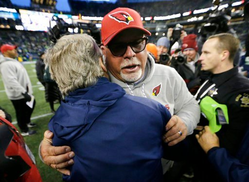 (AP Photo/John Froschauer). Arizona Cardinals head coach Bruce Arians, front right, hugs Seattle Seahawks head coach Pete Carroll, left, after an NFL football game, Sunday, Dec. 31, 2017, in Seattle.