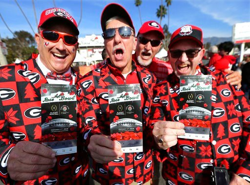 (Curtis Compton/Atlanta Journal-Constitution via AP). Georgia fans Keith Scott, from left, J.P. Harris, Harold Franklin and Keith Barker have their tickets in hand as they arrive for the College Football Playoff Semifinal against Oklahoma at the Rose B...