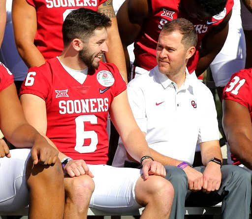 (Curtis Compton/Atlanta Journal-Constitution via AP). Oklahoma quarterback Baker Mayfield talks with coach Lincoln Riley during the official team photo at the Rose Bowl on Sunday, Dec. 31, 2017, in Pasadena, Calif. Georgia plays Oklahoma on Monday in a...