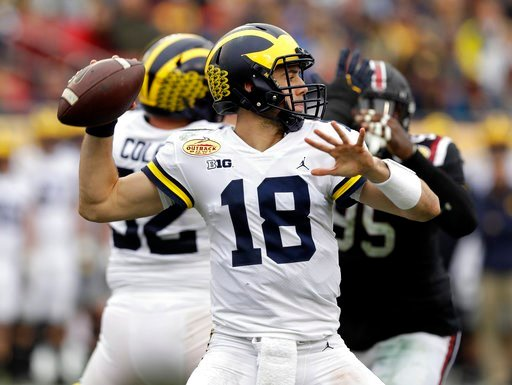 (AP Photo/Chris O'Meara). Michigan quarterback Brandon Peters (18) throws a pass against South Carolina during the first half of the Outback Bowl NCAA college football game Monday, Jan. 1, 2018, in Tampa, Fla.