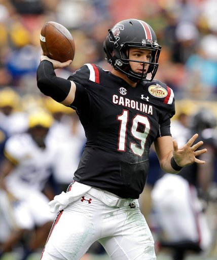 (AP Photo/Chris O'Meara). South Carolina quarterback Jake Bentley throws a pass against Michigan during the first half of the Outback Bowl NCAA college football game Monday, Jan. 1, 2018, in Tampa, Fla.