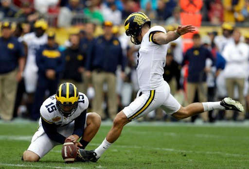 (AP Photo/Chris O'Meara). Michigan kicker Quinn Nordin (3) prepares to make a field goal against South Carolina during the first half of the Outback Bowl NCAA college football game Monday, Jan. 1, 2018, in Tampa, Fla. Holding is Garrett Moores.