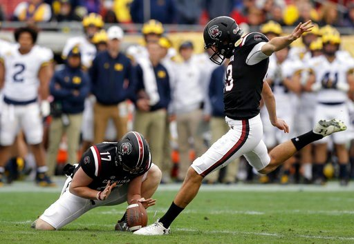 (AP Photo/Chris O'Meara). South Carolina place kicker Parker White prepares to kick a field goal against Michigan during the first half of the Outback Bowl NCAA college football game Monday, Jan. 1, 2018, in Tampa, Fla. Holding is Danny Gordon.