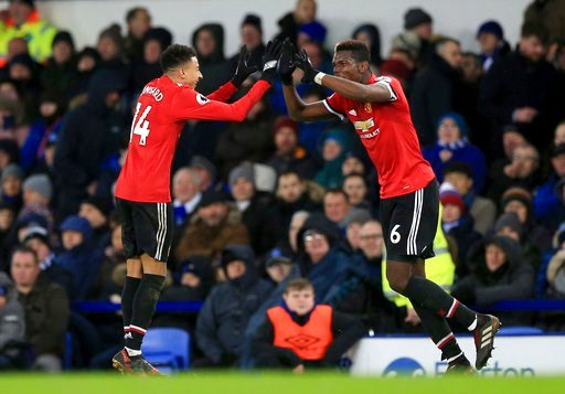(Peter Byrne/PA via AP). Manchester United's Jesse Lingard, left celebrates scoring his side's second goal of the game, during the English Premier League soccer match between Everton and Manchester United, at Goodison Park, in Liverpool, England, Monda...