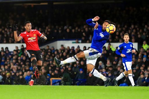 (Peter Byrne/PA via AP). Manchester United's Anthony Martial, left, scores his side's first goal of the game, during the English Premier League soccer match between Everton and Manchester United, at Goodison Park, in Liverpool, England, Monday, Jan. 1,...