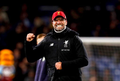 (Martin Rickett/PA via AP). Liverpool manager Jurgen Klopp celebrates after the final whistle of the English Premier League soccer match between Burnley and Liverpool, at Turf Moor, in Burnley, England, Monday Jan. 1, 2018.