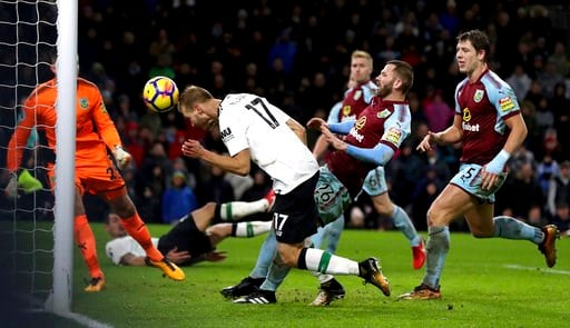 (Martin Rickett/PA via AP). Liverpool's Ragnar Klavan, second left, scores his side's second goal of the game during the English Premier League soccer match between  Burnley and Liverpool, at Turf Moor, in Burnley, England, Monday Jan. 1, 2018.
