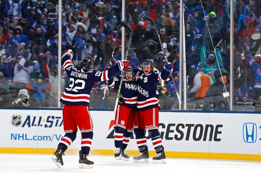 (AP Photo/Adam Hunger). New York Rangers left wing J.T. Miller (10) celebrates scoring the game winning goal with Rangers right wing Mats Zuccarello (36) and Rangers defenseman Kevin Shattenkirk (22) against the Buffalo Sabres in overtime of the NHL Wi...