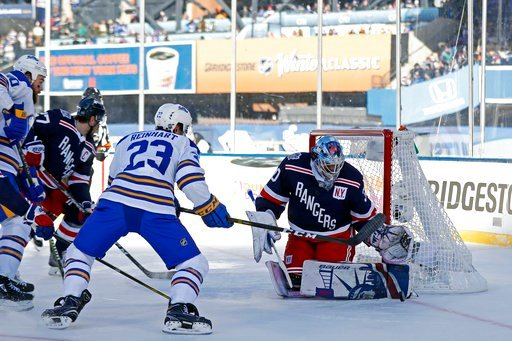 (AP Photo/Adam Hunger). New York Rangers goaltender Henrik Lundqvist (30) makes a save on a shot by Buffalo Sabres center Sam Reinhart (23) in the first period of the NHL Winter Classic hockey game at CitiField in New York on Monday, Jan. 1, 2018.