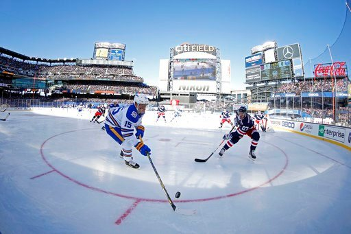 (AP Photo/Adam Hunger). Buffalo Sabres center Jack Eichel (15) controls the puck in front of New York Rangers defenseman Ryan McDonagh (27) in the first period of the NHL Winter Classic hockey game at CitiField in New York on Monday, Jan. 1, 2018.