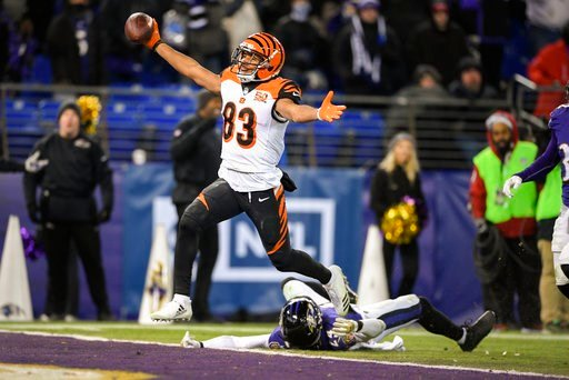 (AP Photo/Nick Wass). Cincinnati Bengals wide receiver Tyler Boyd (83) reacts as he scores the winning touchdown as Baltimore Ravens cornerback Brandon Carr (24) lies on the ground during the second half of an NFL football game in Baltimore, Sunday, De...