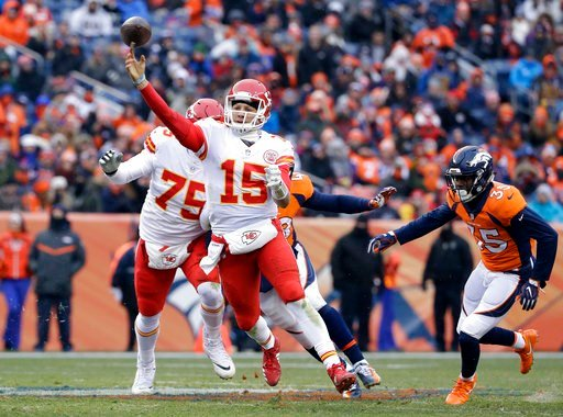(AP Photo/Joe Mahoney). Kansas City Chiefs quarterback Patrick Mahomes (15) throws as Denver Broncos defensive back Dymonte Thomas (35) chases him during the first half of an NFL football game Sunday, Dec. 31, 2017, in Denver.