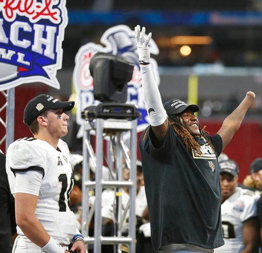 (AP Photo/John Bazemore). Central Florida linebacker Shaquem Griffin, right, and Central Florida quarterback McKenzie Milton (10) celebrate after the Peach Bowl NCAA college football game against Auburn, Monday, Jan. 1, 2018, in Atlanta. Central Florid...