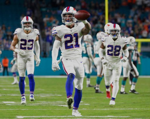 (AP Photo/Lynne Sladky). Buffalo Bills free safety Jordan Poyer (21) shows the ball after he intercepted a pass late in the second half of an NFL football game against the Miami Dolphins, Sunday, Dec. 31, 2017, in Miami Gardens, Fla. The Bills defeated...