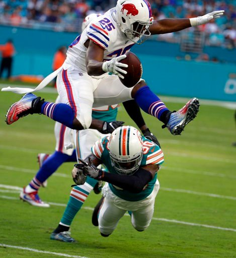 (AP Photo/Lynne Sladky). Buffalo Bills running back LeSean McCoy (25) jumps over Miami Dolphins cornerback Cordrea Tankersley (30), during the first half of an NFL football game, Sunday, Dec. 31, 2017, in Miami Gardens, Fla.