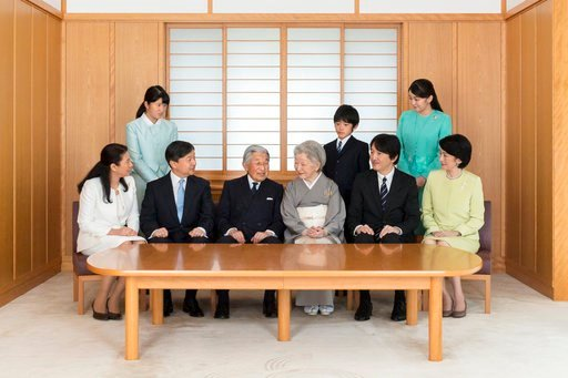 (The Imperial Household Agency of Japan via AP). In this Nov. 4, 2017 photo provided by the Imperial Household Agency of Japan, Japan's Emperor Akihito, center left,  and Empress Michiko, center right, smile with their family members during a photo ses...