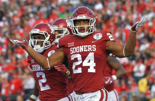 (AP Photo/Mark J. Terrill). Oklahoma running back Rodney Anderson reacts after scoring his second touchdown of the first half of the Rose Bowl NCAA college football game against Georgia Monday, Jan. 1, 2018, in Pasadena, Calif.
