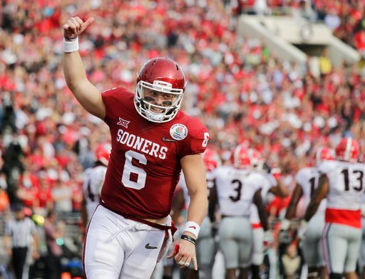 (AP Photo/Jae C. Hong). Oklahoma quarterback Baker Mayfield celebrates after running back Rodney Anderson scored a touchdown against Georgia during the first half of the Rose Bowl NCAA college football game Monday, Jan. 1, 2018, in Pasadena, Calif.