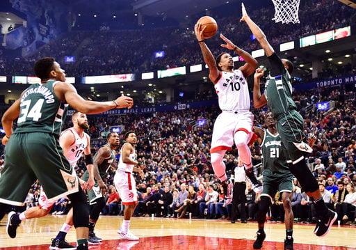 (Frank Gunn/The Canadian Press via AP). Toronto Raptors guard DeMar DeRozan (10) shoots over Milwaukee Bucks forward John Henson (31) during first half NBA basketball action in Toronto on Monday, Jan. 1, 2018.