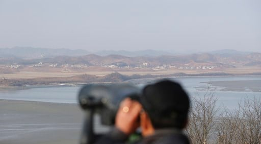 (AP Photo/Lee Jin-man). A visitor uses binoculars to see the North Korea side from the unification observatory in Paju, South Korea, Monday, Jan. 1, 2018.