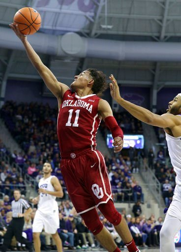 (AP Photo/ Richard W. Rodriguez). Oklahoma guard Trae Young (11) goes up for a shot against TCU during the first half of an NCAA college basketball game, Saturday, Dec. 30, 2017.