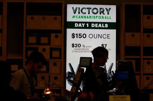 (AP Photo/Mathew Sumner). A lighted sign advertises deals at Harborside marijuana dispensary, Monday, Jan. 1, 2018, in Oakland, Calif. Starting New Year's Day, recreational marijuana can be sold legally in California.